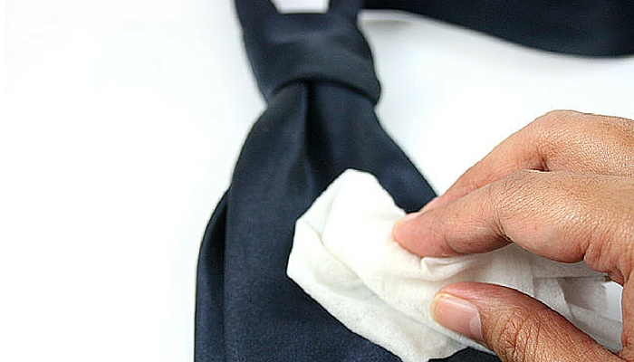 cleaning blue tie